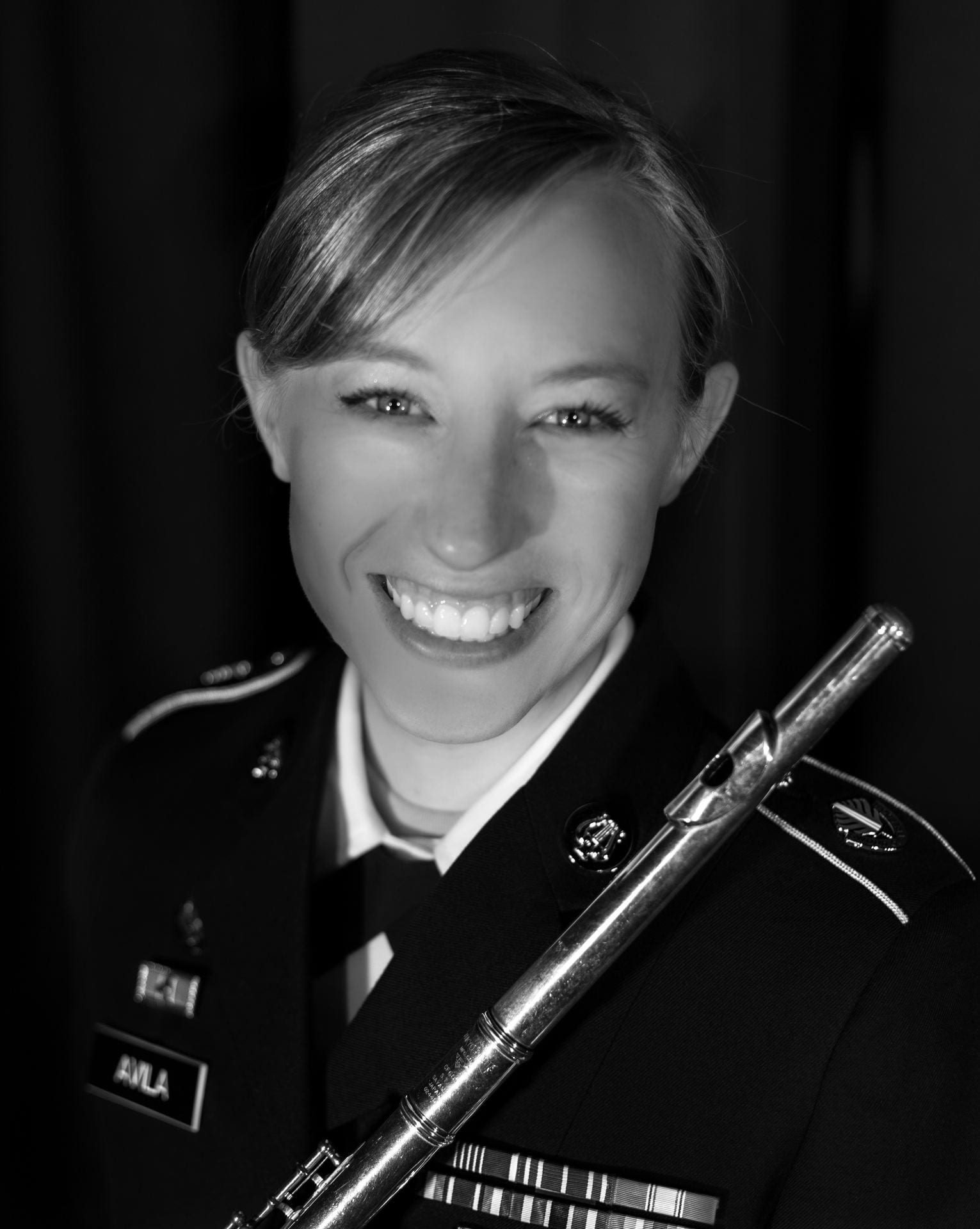 Alum Valeria Cowan in her armed forces uniform with her flute.