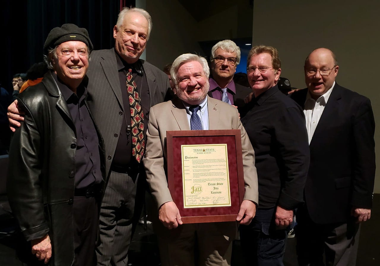 TXST Faculty, from Left to Right: Butch Miles, Doug Lawrence, Dr. Clark, Keith Winking, Hank Hehmsoth, and Loren Schoenberg.