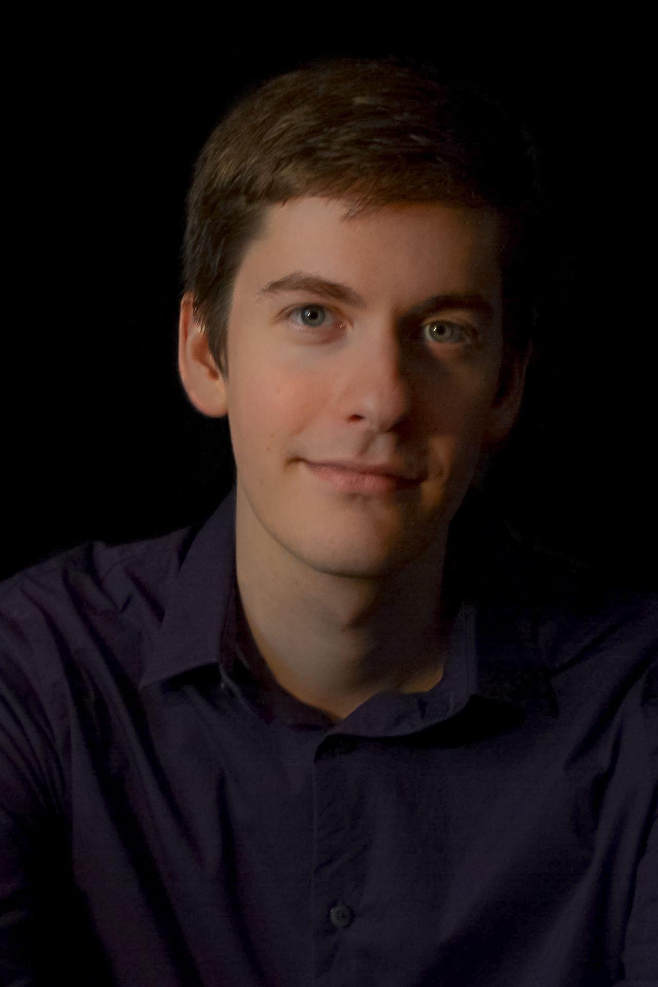 Headshot of graduate student John Vinzant