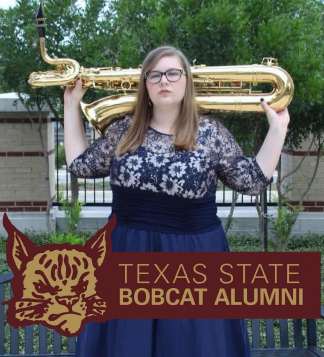 Nicole Richardson holding a bari saxophone