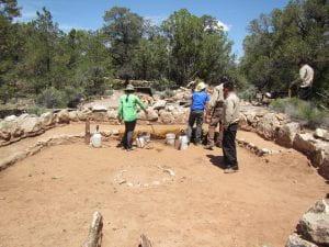 Fig. 3: Anna Provenzano (far left) working with members of the Arizona Conservation Corps in the kiva at the Tusayan Ruin in Grand Canyon National Park.