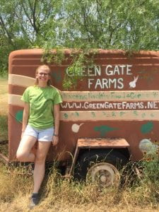 I stand by an old Green Gate Farms trailer on my last day.