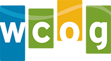 Whatcom Council of Government's (WCOG) logo in blue, green and yellow