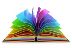 A book open on the spine with rainbow colored pages