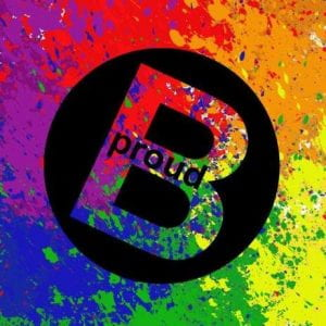 Text reads B Proud. Paint splatters in red, orange, yellow, green, blue and violet surround black circle. Inside circle is letter B with word proud written inside the B.