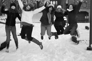 WWU students jumping in the snow