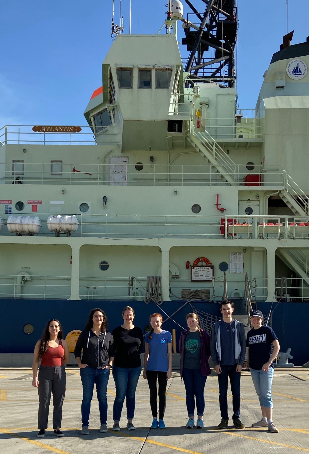Arellano Lab standing in front of the R/V Atlantis