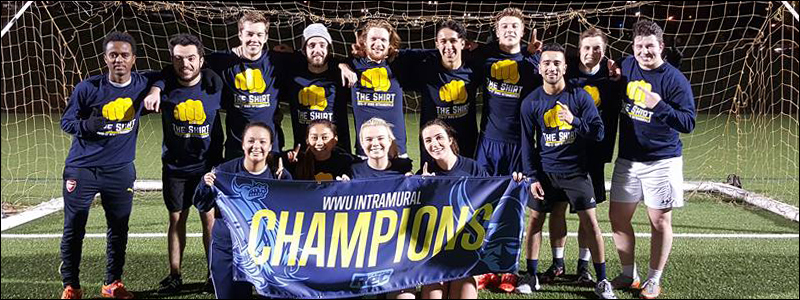WWU Intramural champions in soccer pose in front of a goal on the field