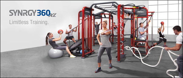 Several people working out on a multi-functional fitness machine