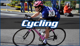 Cycling written across a WWU cycling team member on a pink road bike leaning into a turn