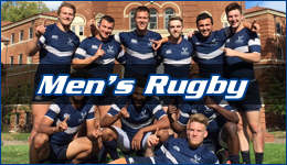 Men's Rugby written across the team posing in front of a large brick building