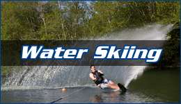 Water Skiing written across a team member cutting around a corner with several feet of water spray in the air behind them