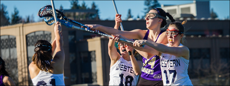 WWU Women's Lacrosse fights for the ball against University of Washington