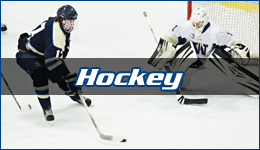Hockey written across WWU forward coming in to shoot on a University of Washington Goaltender