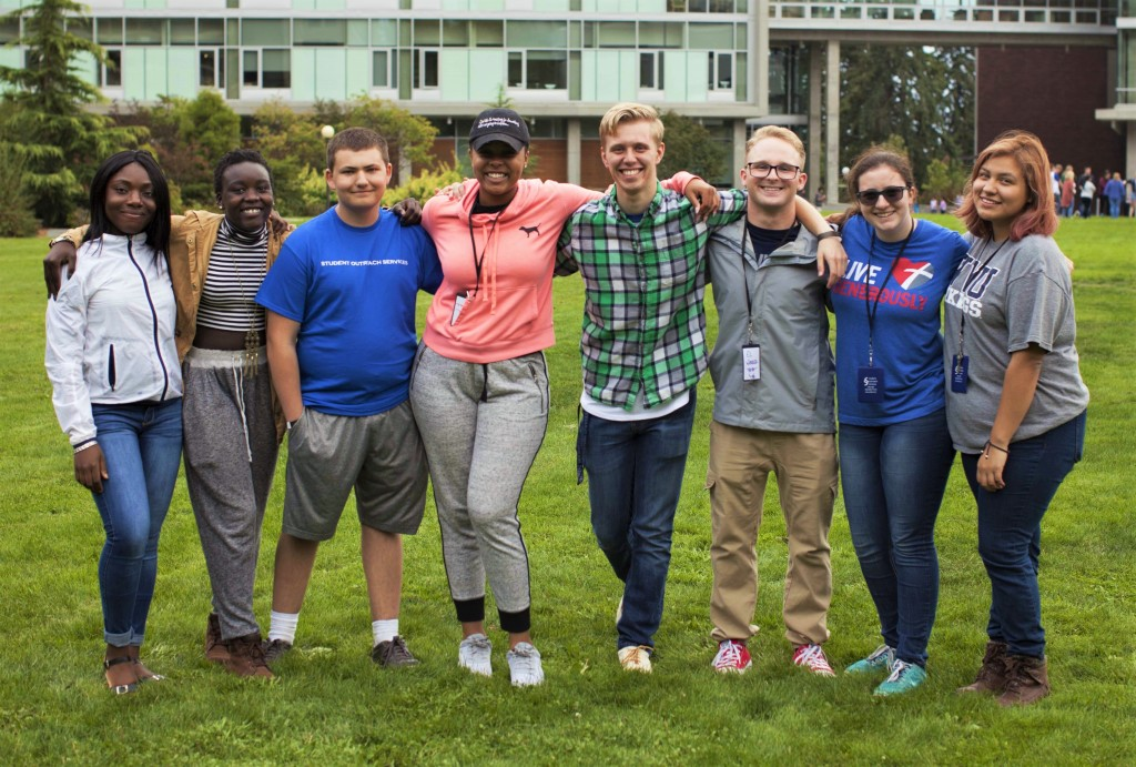8 SOS Students in a line on the Communications Lawn