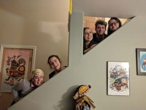 Students posed on a staircase