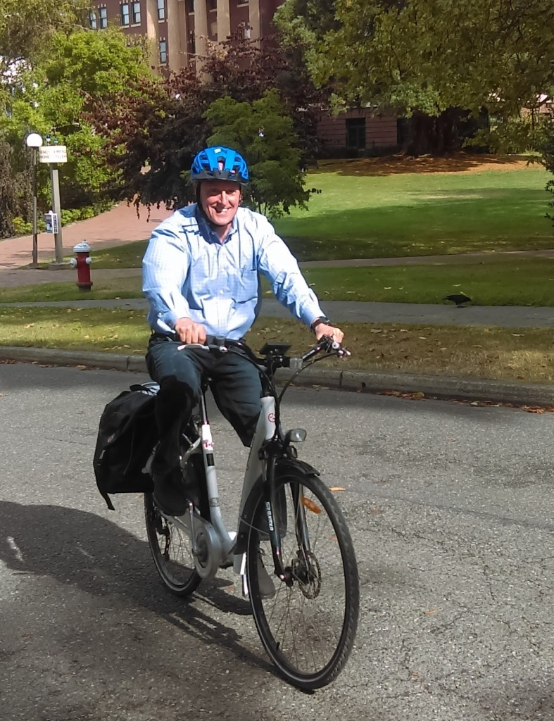 Tim Szymanowski rides a Viking eBike up High Street