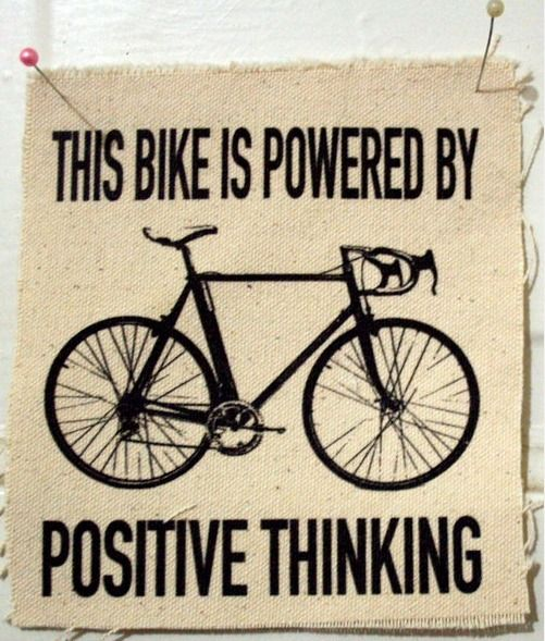 """This bike is powered by positive thinking"" and bike on cloth"