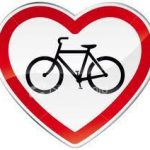 graphic bike within heart outline