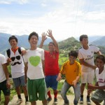 Jhamtse Gatsal Children's Community 8th and 9th grade boy's volleyball team excited on a sunny day