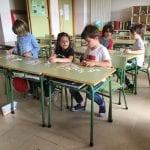 Children play a game at school desks