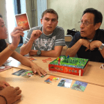 Students play a card game
