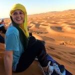 Student in front of desert landscape