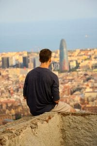 Student overlooks a large city