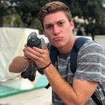 Student holding a bird