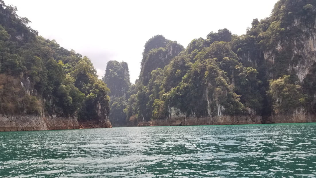 A view of the steep cliffs rising from the water at Khao Sok.