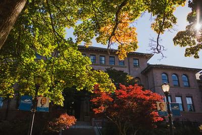 Fall trees and Old Main facade