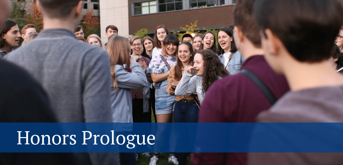 Honors Prologue – Image of group huddled around two students playing Bear, Salmon, Mosquito