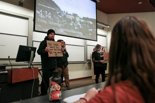 Protesters gave a 20 minute introduction to Johnathan Zimmerman's talk. Jaden Moon // AS Review