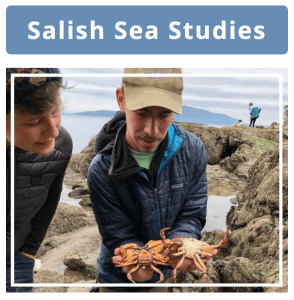Student holding male and female crab while tidepooling