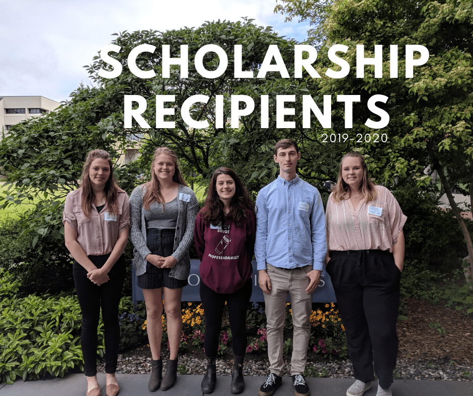 Group photo of five previous scholarship recipients standing in front of a tree