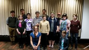 A picture of a group of out in science students and faculty and guests with astronaut Wendy Lawrence and her partner, taken in 2016.