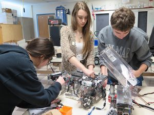 Group of students making a robot