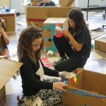 Students constructing cities out of cardboard at 2017 steam expo