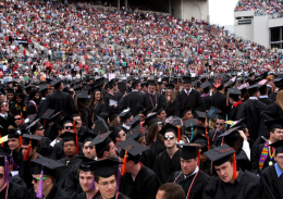 Shelby Lum / Photo editor OSU students stand with their colleges at the OSU Spring Commencement on May 5 at Ohio Stadium.