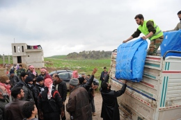The Free Syrian Army's Farouq Brigade passes out tents to people still living in the open or in caves near al Sahriah in January.
