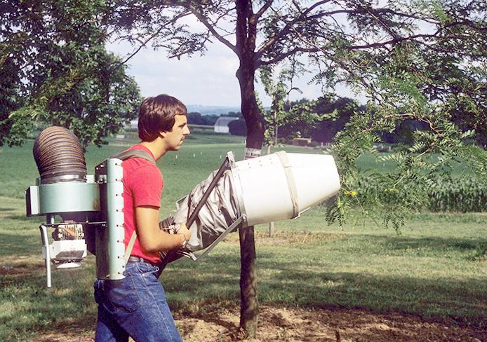 Daniel Herms, OSU entomology department chair, D-Vac sampling trees as a student. Credit: Courtesy of Julie Gaier