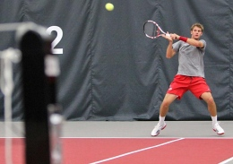 Ohio State junior Blaz Rola returns a serve in a match against Wisconsin on April 5. OSU won, 7-0.