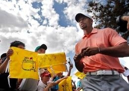 Courtesy of MCT Tiger Woods signs autographs before The Master at Augusta National Golf Club in Augusta, Ga., on April 9