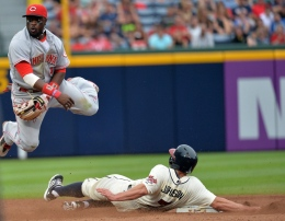 Cincinnati Reds second baseman Brandon Phillips throws to first base after forcing out the Atlanta Braves' Reed Johnson (7) in the eighth inning at Turner Field in Atlanta, Georgia, on Saturday, July 13, 2013. The Braves won, 5-2.