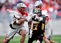 Senior midfielder Dominique Alexander fights for position during a game against Towson on May 12, 2013 at Ohio Stadium. OSU won, 16-6.