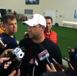 Eric Seger / Sports editor Ohio State wide receivers coach Zach Smith speaks with reporters after practice Aug. 10 at the Woody Hayes Athletic Center.