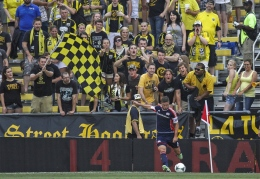 New England Revolution midfielder Chris Tierney takes a corner kick against the Columbus Crew in unfriendly territory in Crew Stadium in Columbus, Ohio, Saturday, July 20, 2013. The Revolution scored two goals in stoppage time to win the match, 2-0.