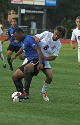 Shelby Lum / Photo editor Junior Yianni Sarris battles for the ball during a game against IPFW on Aug. 20, at Jesse Owens Memorial Stadium. OSU won, 2-0.