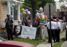 Police guard Gina DeJesus' house in Cleveland May 7. DeJesus, Amanda Berry and Michelle Knight were found May 6 a few blocks away from where they went missing about a decade ago in Cleveland.