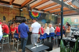 "People gather at the Union Cafe in Columbus June 26 for a ""DOMA is Dead"" celebration after the US Supreme Court's ruling to overturn DOMA."